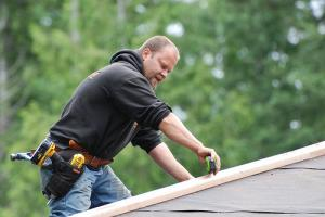 a roof patch job being performed by a San Mateo handyman
